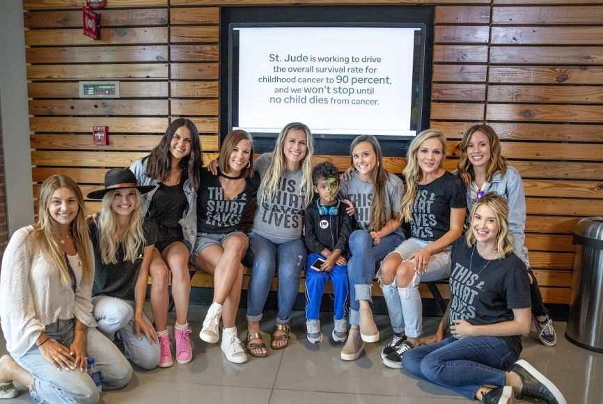 Brittney Kelley, Hannah Mooney, Abby Smyers, Catherine Nail, Caroline Hobby, Gabi McCreery, Kristen Brust, Christy Smith, and Hayley Hubbard meet a St. Jude patient