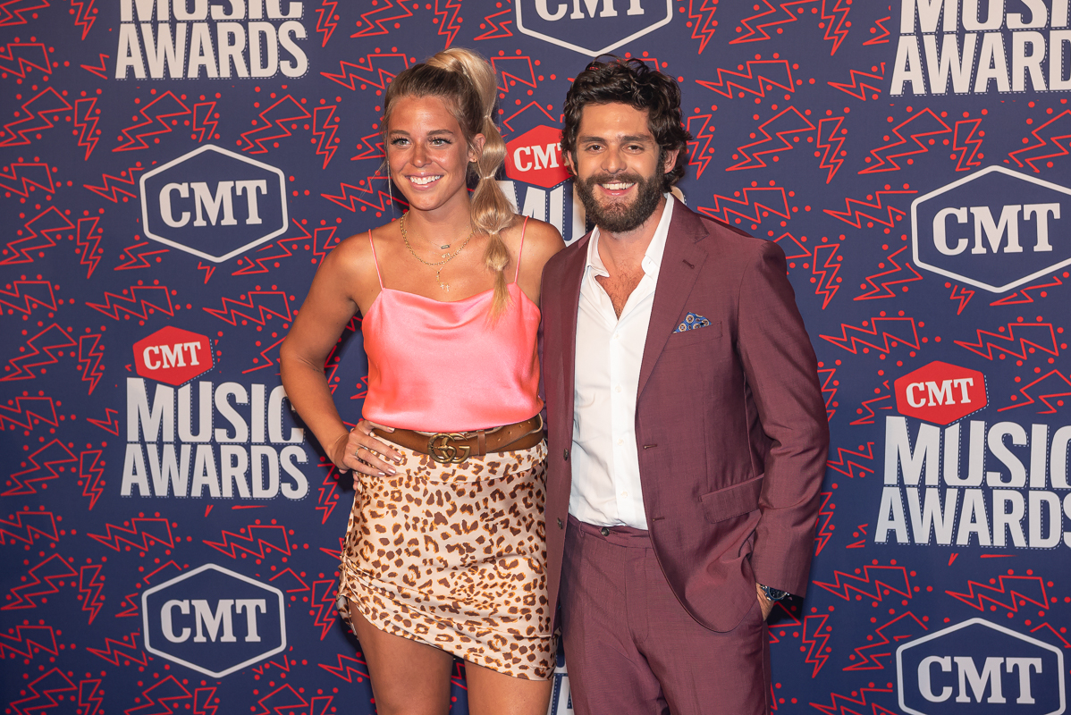 Thomas Rhett with wife Lauren; Photo by Andrew Wendowski