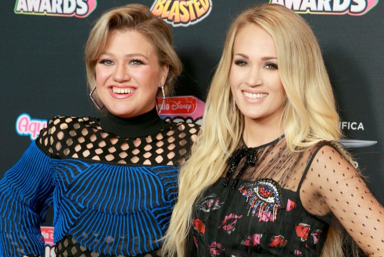 Kelly Clarkson and Carrie Undewood; Photo by Rich Fury/Getty Images