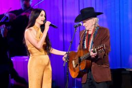Kacey Musgraves and Willie Nelson; Photo by Terry Wyatt/Getty Images