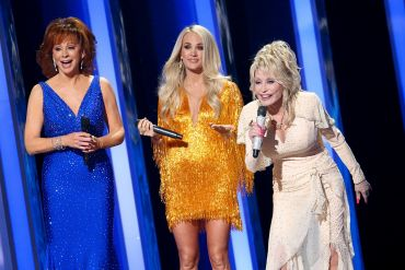 Reba McEntire, Carrie Underwood, Dolly Parton; Photo by Terry Wyatt/Getty Images