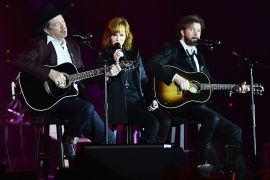 Kix Brooks of Brooks & Dunn, Reba McEntire, and Ronnie Dunn of Brooks & Dunn; Photo by Emma McIntyre/Getty Images for Celebrity Fight Night
