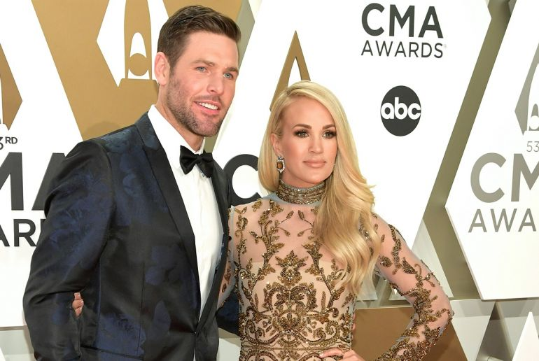 Mike Fisher and Carrie Underwood; Photo by Jason Kempin/Getty Images