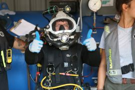 Bobby Bones in diving gear at the Divers Institute of Technology. (Credit: National Geographic/Gil Cano)