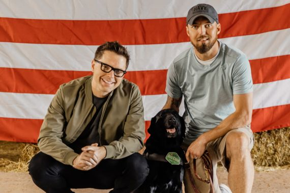 Dog Chow partner and TV/radio personality Bobby Bones with Veteran Andy and his service dog Storm participate in the fourth annual Dog Chow Service Dog Salute campaign